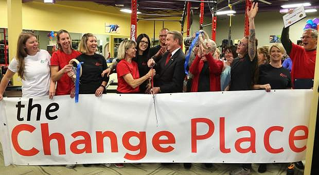 The Change Place co-owner Sherry Newsom and Mayor Bob Crowell cut the ribbon during a grand opening ceremony on Tuesday night. The Change Place is located in the Eagle Medical Center plaza.