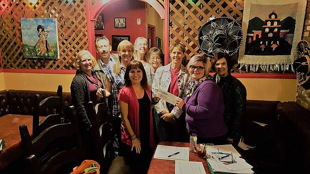 The Board of the High Sierra Swing Dance Club presents Traci Trenoweth from Advocates to End Domestic Violence with a check of $450. The club donated profits from its September monthly dance to the organization, along with some private donations from club members. Advocates is a private, not-for-profit organization that provides support and services to battered women and their children. For more information, go to www.aedv.org. For more about the nonprofit High Sierra Swing Dance Club, go to www.highsierrasdc.org.