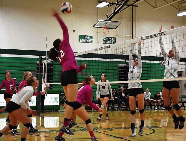 Kaitlin Rizzo (12) of Elko goes up for a shot against Fallon in a match played  in late October.