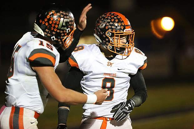 Ryland DeSomber is congratulated by Michael Cobb in the end zone after scoring at Reed High School Thursday night.