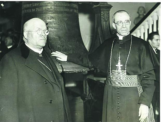 Eugenio Cardinal Pacelli (right, the future Pope Pius XII), with Cardinal Dougherty, visiting the Liberty Bell in Philadelphia during his United States Tour in 1936, which included Boulder City and Hoover Dam in Nevada.