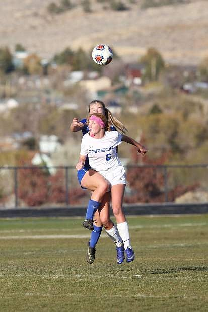 Molly Otto fights for the ball for Carson on Thursday.