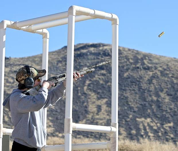 16-year-old North Valleys High School student Joseph Lumsden competes in his third sporting clays competition Saturday at the Rocky Mountain Elk Foundation's Veteran's Day compeition at the Capital City Gun Club.