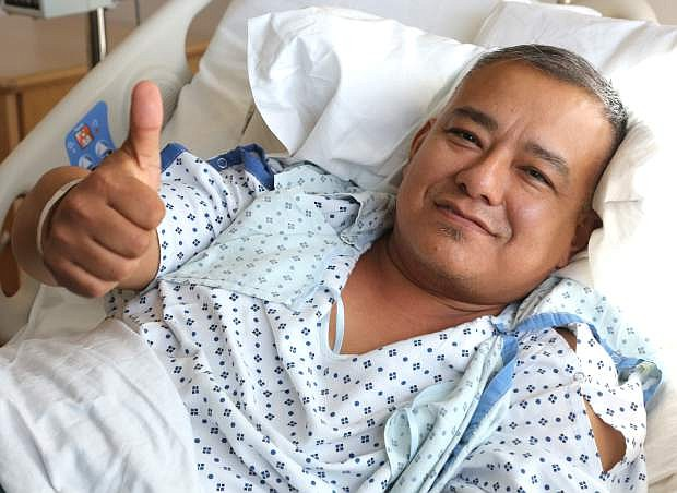 Richard Torres, 46, gives a thumbs up from his bed at the Carson Tahoe Regional Medical Center after casting his ballot on Tuesday.