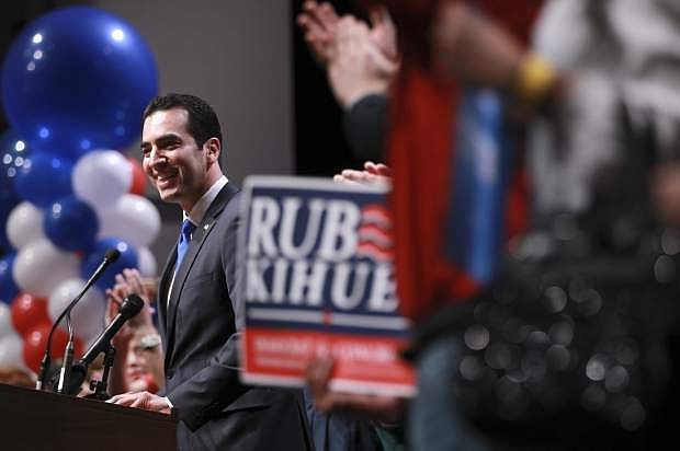 """FILE - In this Nov. 8, 2016, file photo, Rep. Ruben Kihuen, D-Nev., speaks to supporters after his victory at an election watch party in Las Vegas. Nevada has become an election case study for Democrats after it went blue while much of the country went red. The purest success story for the """"Reid machine"""" is Kihuen, a Mexican immigrant and son of a casino housekeeper who unseated an incumbent Republican congressman with help from heavy-hitting fans, Sen. Harry Reid, Bill Clinton and the formidable, highly immigrant Culinary Union that represents casino workers like his mom. (AP Photo/Chase Stevens, File)"""