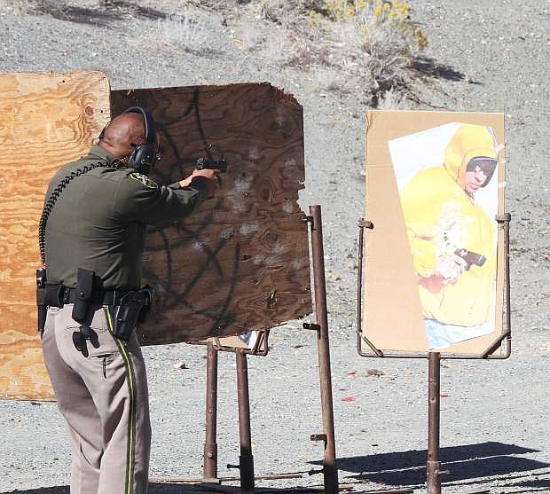 """Deputy Izzy Loyola shoots at an """"armed suspect"""" at the gun range for the Carson City Sheriff's Office In Service Training and firearms qualifications."""