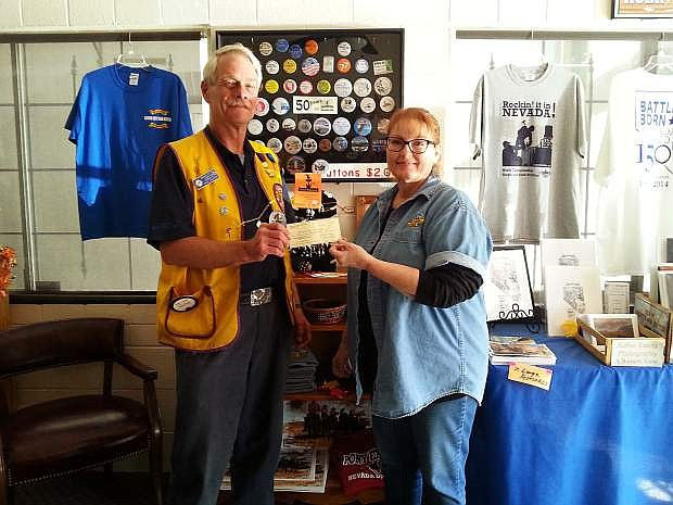 Carson Host Lions Rick Jackson presenting $1,000 check for Nevada Day Button sales to Janet Baker, president of Nevada Day Committee.