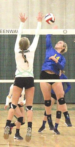 Hannah Hillyer (14) of Lowry tries to power the ball against Fallon's Whitney Skabelund.