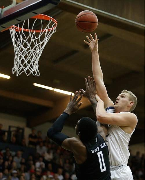 Saint Mary's Jock Landale, right, shoots over Nevada's Cameron Oliver (0)  defends against Saint Mary's Jock Landale earlier this season.