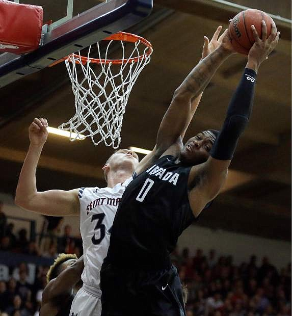 Nevada's Cameron Oliver (0) rebounds over Saint Mary's Jock Landale during the first half of an NCAA college basketball game Friday, Nov. 11, 2016, in Moraga, Calif. (AP Photo/Ben Margot)