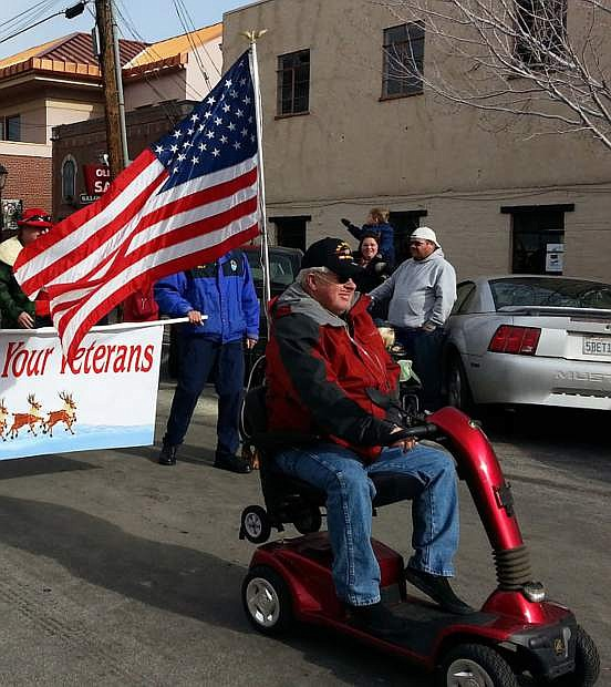 Late dedicated volunteer and veteran Richard Scott participates in the Olde Time Santa Parade in Dec. 2015.