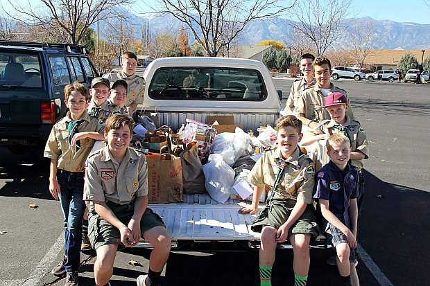 Local Boy Scouts proudly display some of the food collected for local food banks.