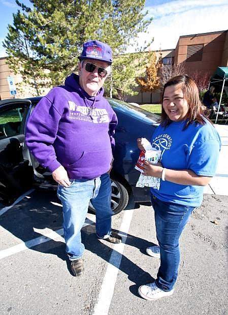 Mia Brozovich accepts Don Sigmon's donation of  toiletries Saturday at Carson High.