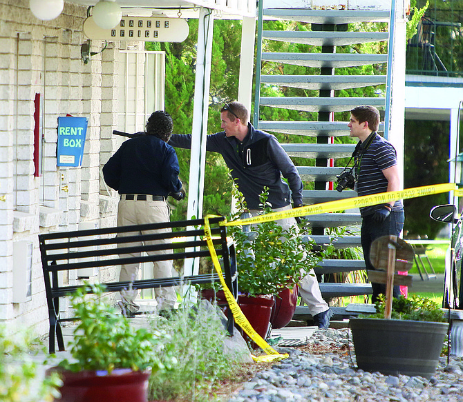 Crime scene investigators arrive at the Senator apartments on Tuesday morning to investigate the site of a fatal shooting.