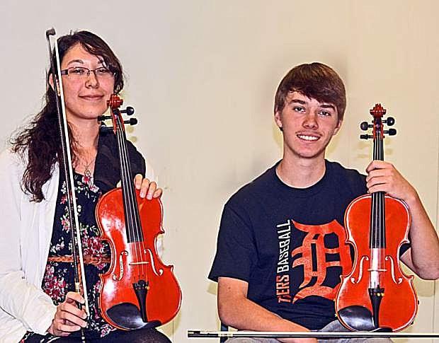 Concertmasters, Faith Adams, a student at WNCC, and Dario Watroba, a sophomore at Douglas High School.