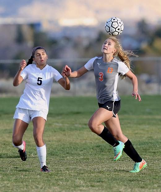 Kyla Hinnant of Douglas goes after a loose ball ina playoff game against McQueen on Tuesday.
