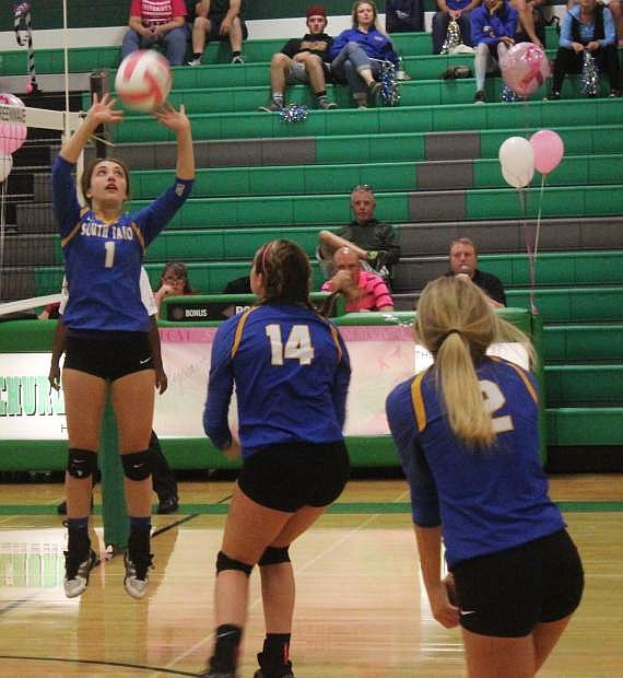Zoe Mosedale (1) of South Tahoe sets the ball up for teammate McKenna Brewer (14).
