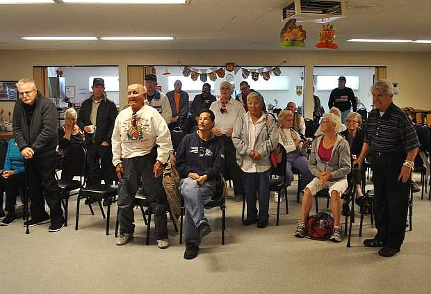 Fallon veterans stand for recognition during a color guard at the Fallon Senior Center.