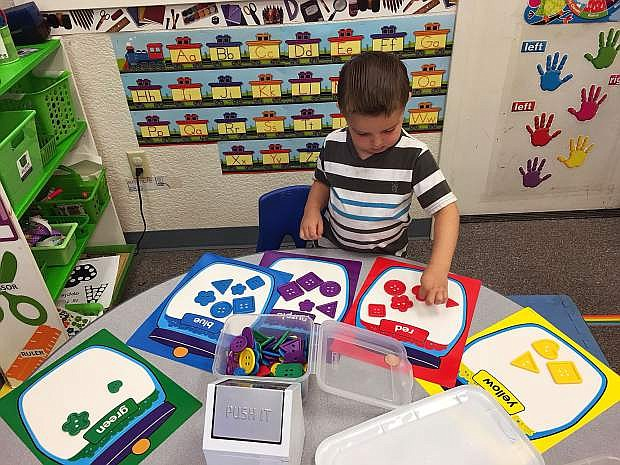 Craighton McNinch works in his classroom.