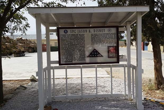 Sr. Airman Eric Woolstom and two other airmen had a special ceremony for unveiling the new sign.