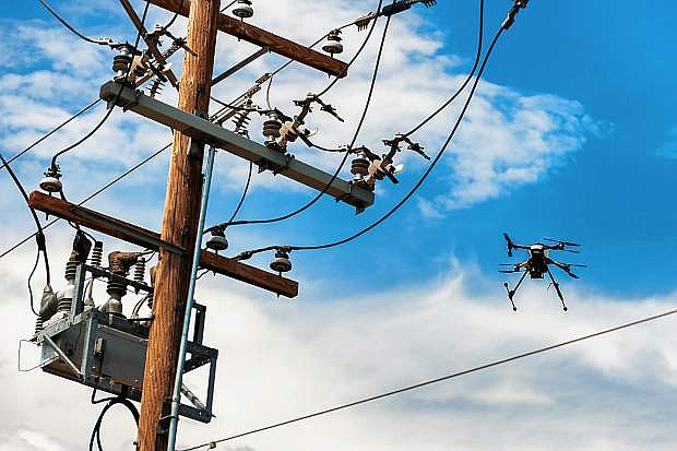 NV Energy engineers and Drone America's flight team use Drone America's NavX UAS to survey a power line using thermal and visual sensor in Nevada.