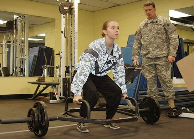 Pvt. Brittany Sears, 18, of Virginia City Highlands, completes the dead lift portion of the Occupational Physical Assessment Test in Stead, Nev., in October. Sears is set to become the first woman in the Nevada Army Guard to hold a combat-occupation role in a front-line unit. If she passes her upcoming training, she'll become a combat engineer in the 609th Engineer Company in Fallon.