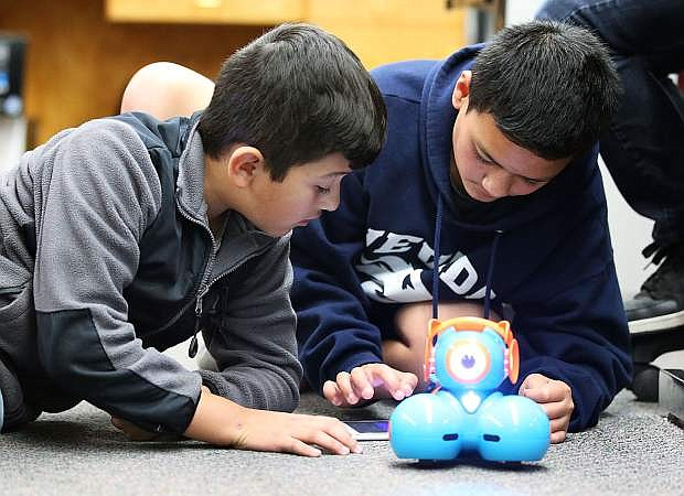 Tristan Perez, left, and David Stoffer, both 11, learn coding skills with a robot at Fritsch Elementary School in Carson City, Nev. on Tuesday, Nov. 15, 2016.