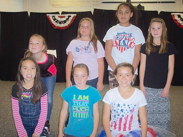 Numa students involved in the veterans' ceremony include back row, from left,  Madison Snide, Isis Paolini, Tia Otuafi and Amelia Bateman. Bottom row from left are Britney Aulner, Bailey Stritenberger and Zoey Jarrett.