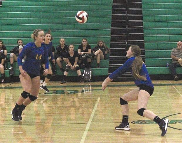 Jadyn Eastman, right, of Lowry sets the ball up for teammate Hannah Hillyer. Lowry fell to Truckee in four sets in the regional volleyball tournament.