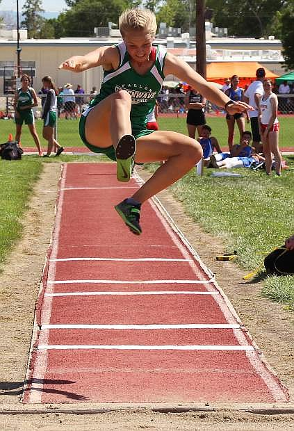 Fallon's Whitney Skabelund jumps for a new record in the triple long jump.