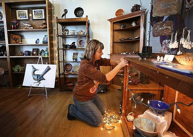 Manager Sarah Morey prepares for Small Business Saturday at the Artisan Store at the Brewery Arts Center in Carson City, Nev. on Wednesday, Nov. 23, 2016. Gallery owners encourage shoppers to consider unique, local art when holiday shopping.