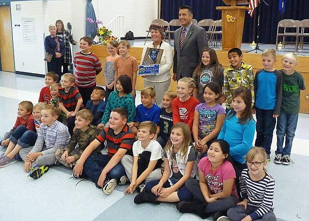 Gov. Brian Sandoval, Nevada teacher of the year Pam Ertel and her class at Minden Elementary School on Friday.