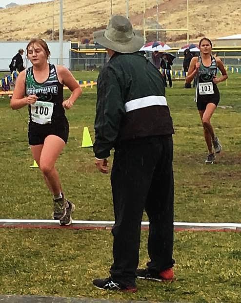 Amanda Pursley (front) and Bailee Walker run in the regional cross country meet.