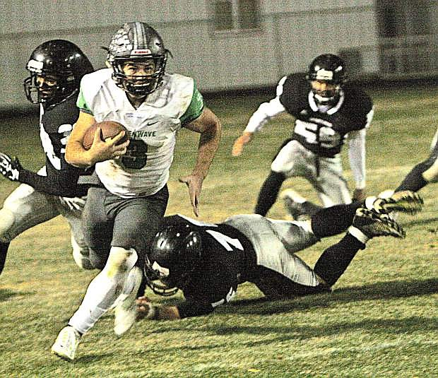 The Greenwave's Conner Nelson gains yardage against Spring Creek Friday night. The Spartans defeated Fallon 38-8.