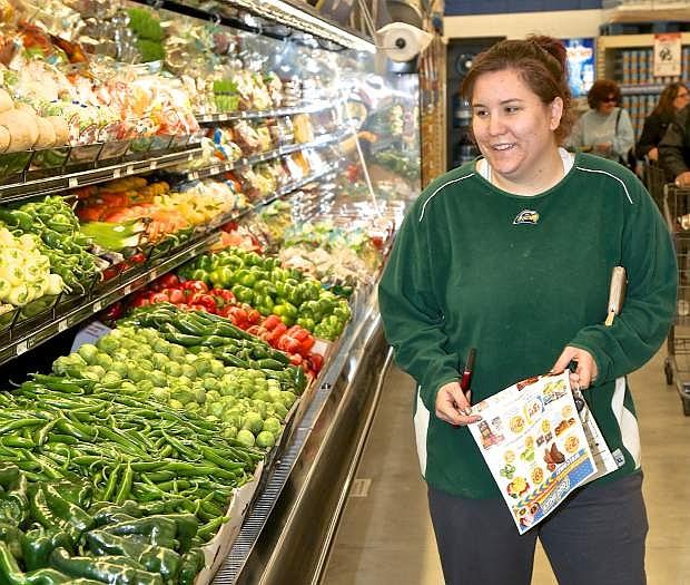 Moriah Lane of Carson City shops for fresh produce Wednesday at the new Food Maxx store.