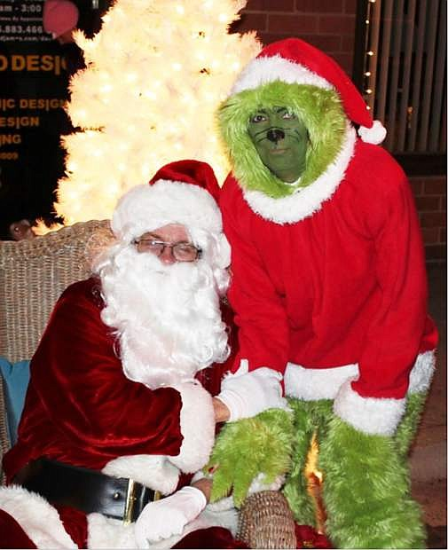 Nick McGahuey as Santa and Kellie George as the Grinch will be appearing at McFadden Plaza today during the annual Silver & Snowflakes Festival of Lights.