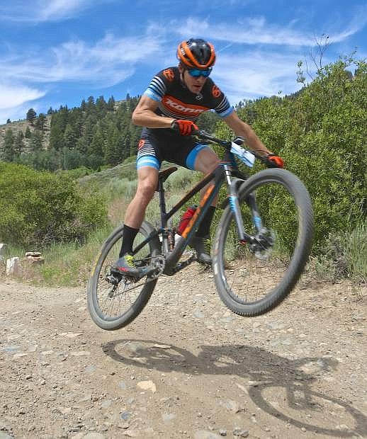 A Kona pro rider gets air off a waterbar coming down King's Canyon while pre-riding the race course Saturday.