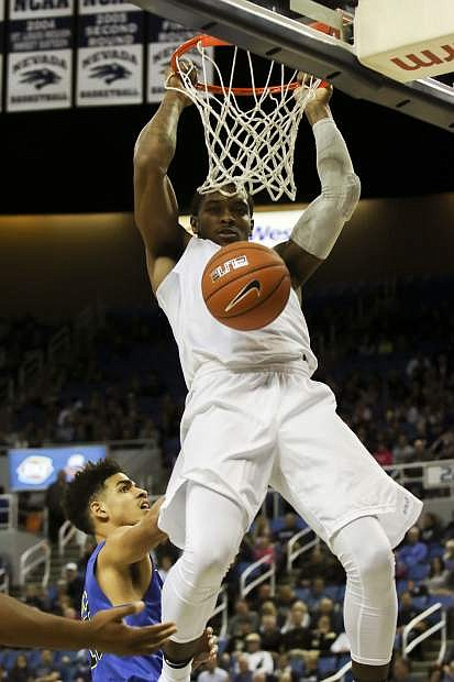 Nevada's Cameron Oliver dunks against San Jose State on Wednesday.