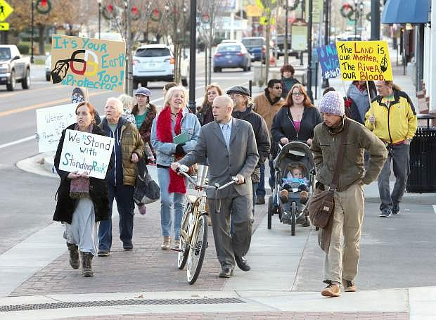 About 25 people march through downtown on Monday afternoon to show their support for the Standing Rock protest in North Dakota.