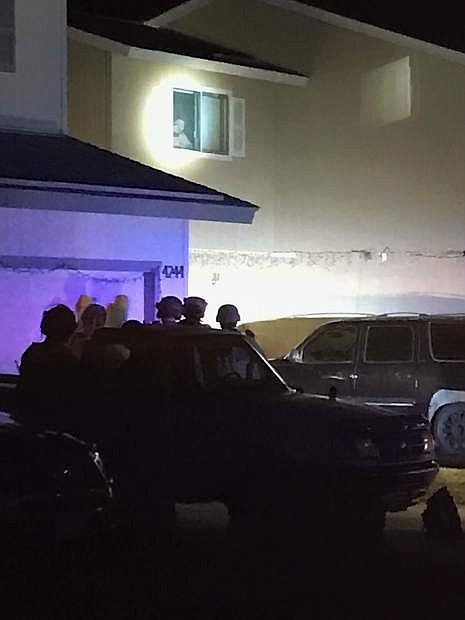 Members of Carson City SWAT prepare to enter an apartment on Pheasant Drive early Saturday morning.