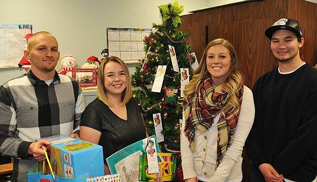 Western Nevada College nursing students, from left, Randall Oxoby, Kelsey Ricketts, Kendall Valdez and Robert Barlow stand in front of the Angel Tree, which is located in Cedar Building Room 231.