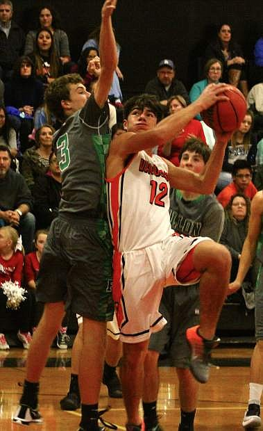 Hayden Strasdin (left) goes to block a shot by Fernley's Ren Arroyo during the Greenwave's Tuesday game in Fernley.