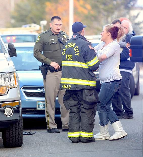 A Carson City Sheriff's deputy and Carson City firefighter work together at the scene of a minor vehicle acident.