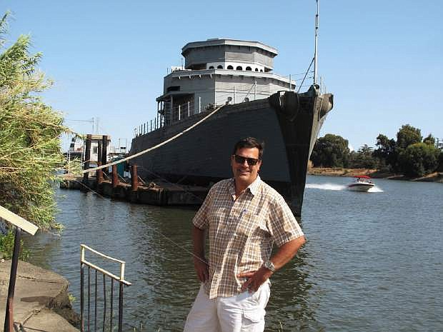 The USS Lucid and David Rajkovich, president of the Stockton Historical Maritime Museum Assn., are photographed at the Sacramento River pier where the ship is undergoing  rehabilitation and partial reconstruction.