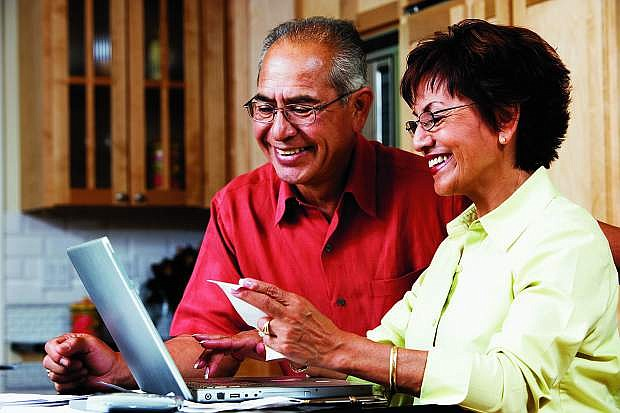 A couple reviews their Medicare plan and its options.