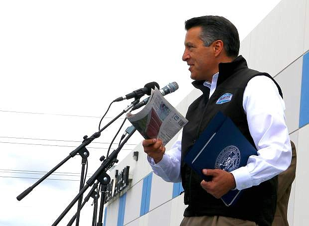 Nevada Gov. Brian Sandoval talks about how he starts his mornings by reading the Nevada Appeal at the Appeal's 150th birthday party Saturday.