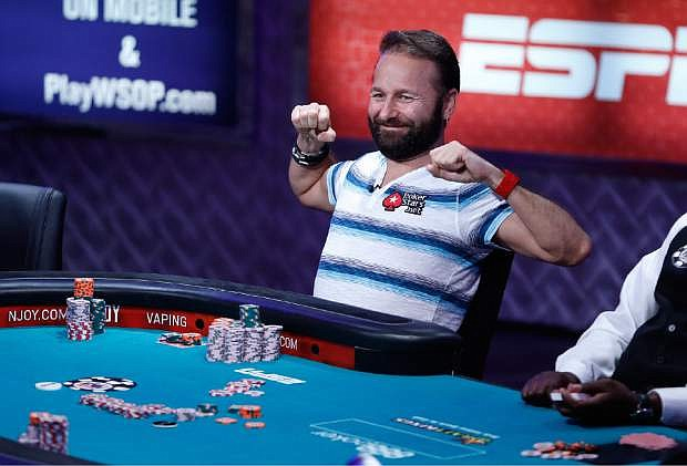 Daniel Negreanu stretches while playing at the World Series of Poker main event Tuesday, July 14, 2015, in Las Vegas. (AP Photo/John Locher)