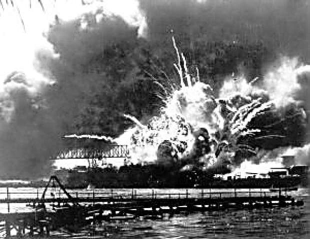 FILE - In this Dec. 7, 1941 file photo, the destroyer USS Shaw explodes after being hit by bombs during the Japanese surprise attack on Pearl Harbor, Hawaii. Saturday marks the 72nd anniversary of the attack that brought the United States into World War II.