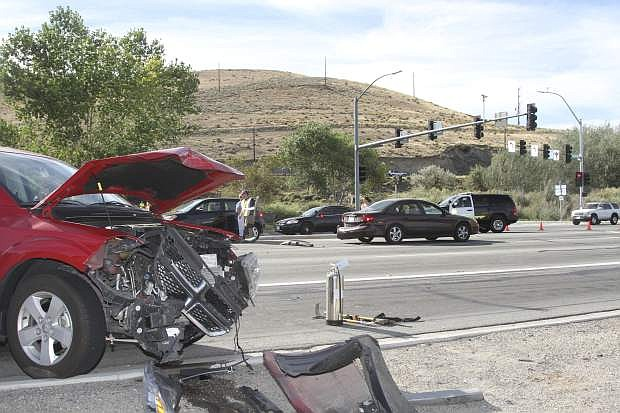 Wrecked vehicles are shown near the intersection of Carson and Fairview in Carson City Saturday.
