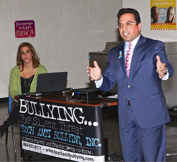 Daniela Redpath, Director of Operations and Dr. Claudio Cerullo of Teach Anti-Bullying Inc. speak to a crowd at the Boys and Girls Club of Western Nevada Thursday evening in Carson City. The Philadelphia, Pa. based non-profit organization is dedicated to working with educators, parents, law enforcement officials and dignitaries on the national bullying crisis in our communities. For more information visit Facebook.com/Teachantibullying